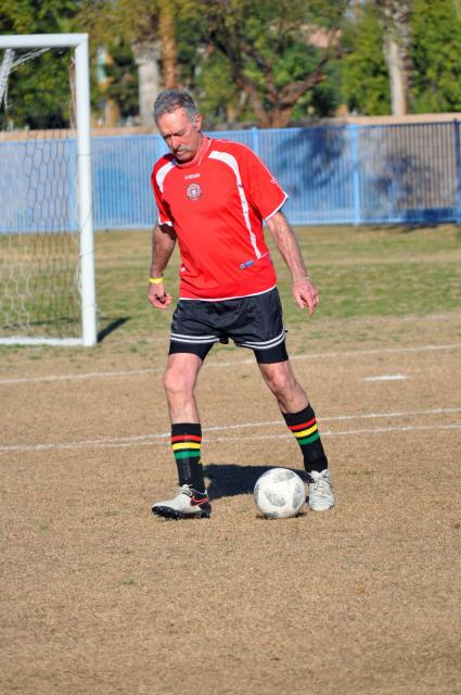 Men's Soccer Player Dribbling the Ball