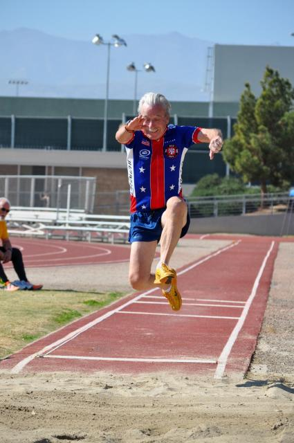 Senior Games participant competing in the long jump