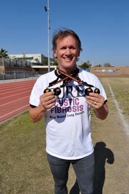 Proud Athlete Shows His Many Medals Won