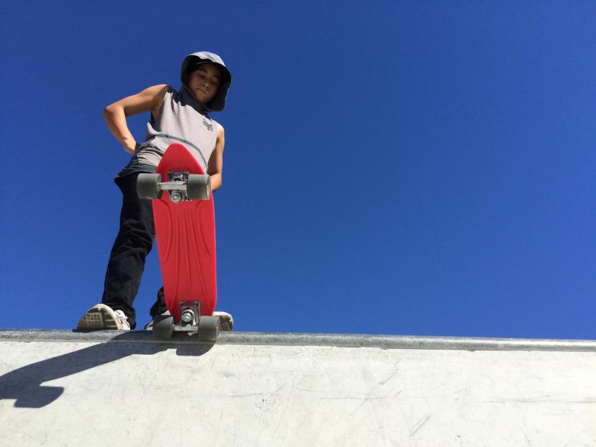 Photo of skateboarder ready to drop into the transition