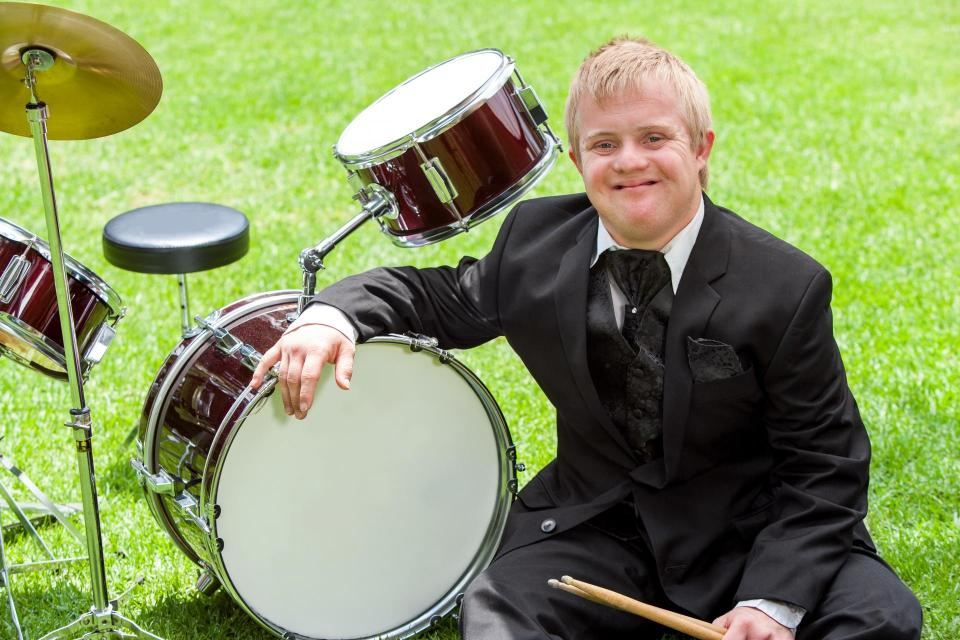 Young man sitting at drum set