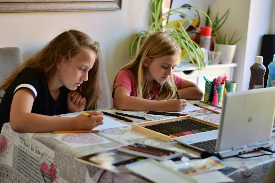Two girls drawing art