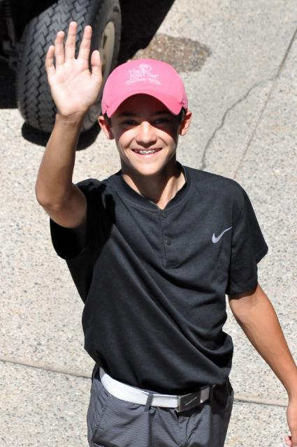 Photo of Braden waving to the camera