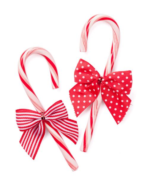 Image of two candy canes with bows
