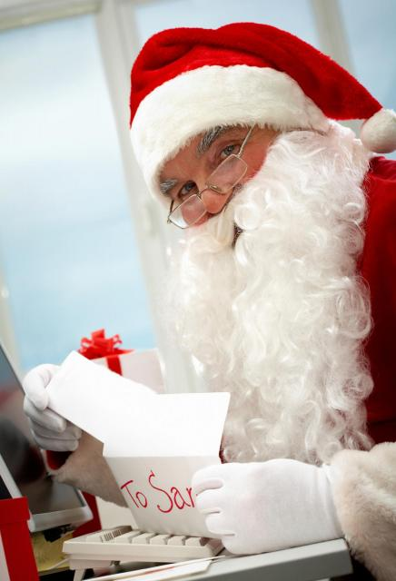 Santa Claus opening letter addressed to him