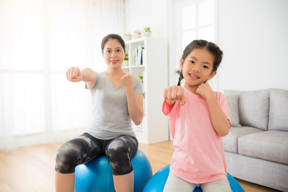 Woman and child doing indoor exercises