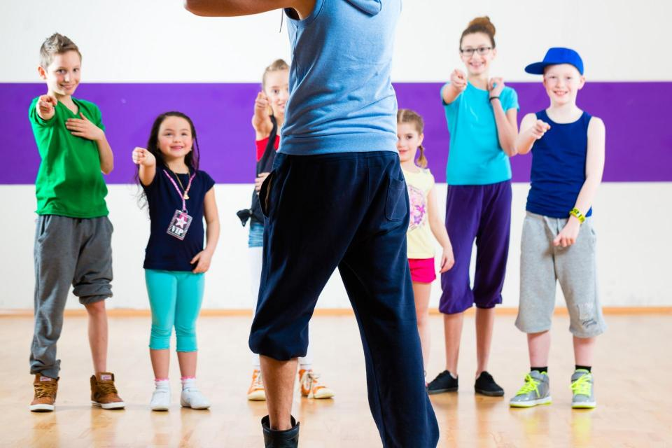 Fitness instructor teaching kids fitness
