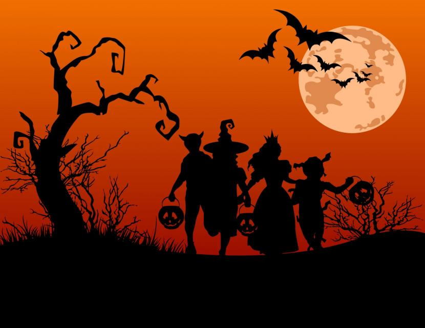 Silhouette of kids trick or treating in illustration