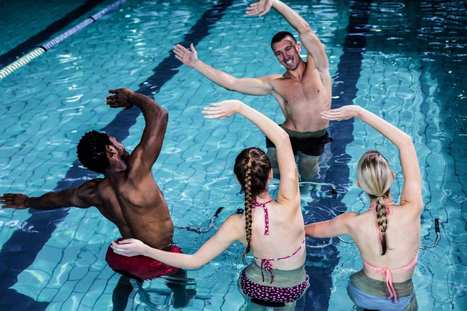 Instructor showing pool exercises and stretching
