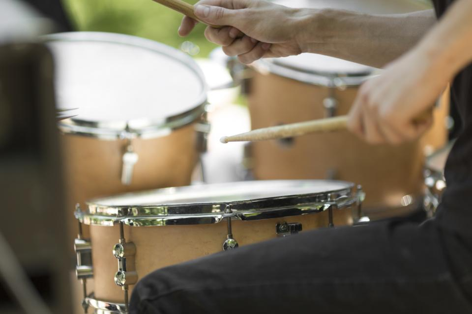 Close up of hands playing drums