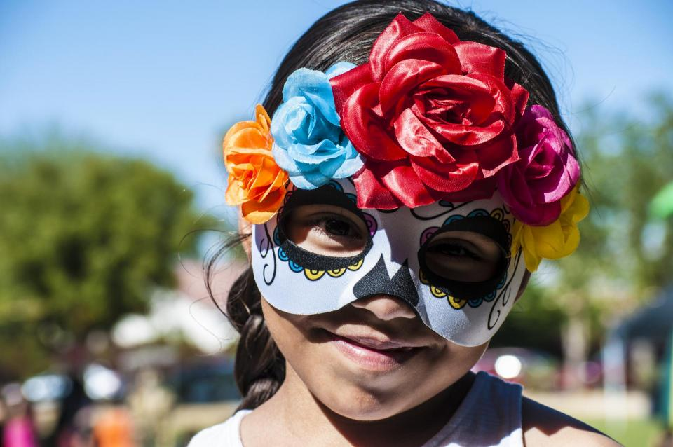 Girl wearing Dia De Los Muertos costume photo