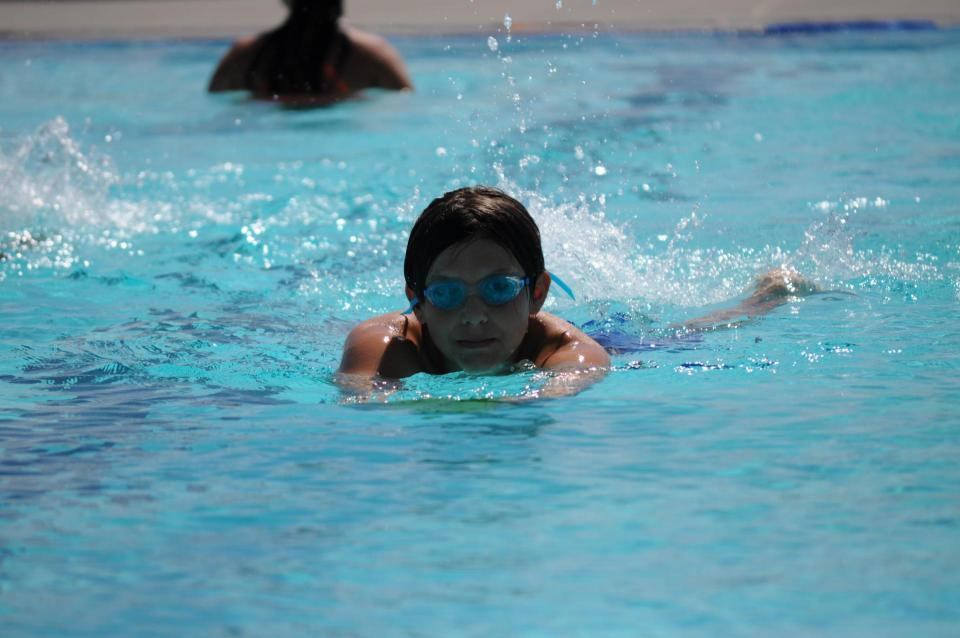 Boy swimming at Pawley Pool photo