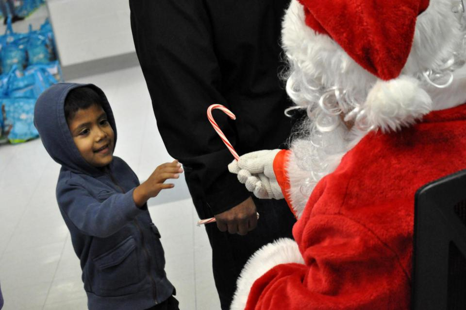 Boy meets Santa Claus