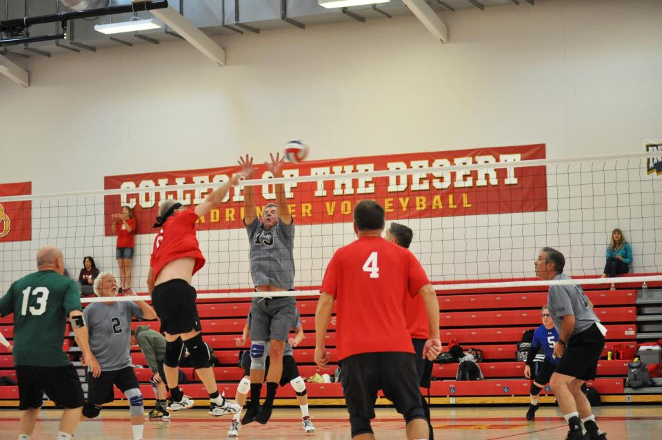 Men's Volleyball game  at the net photo