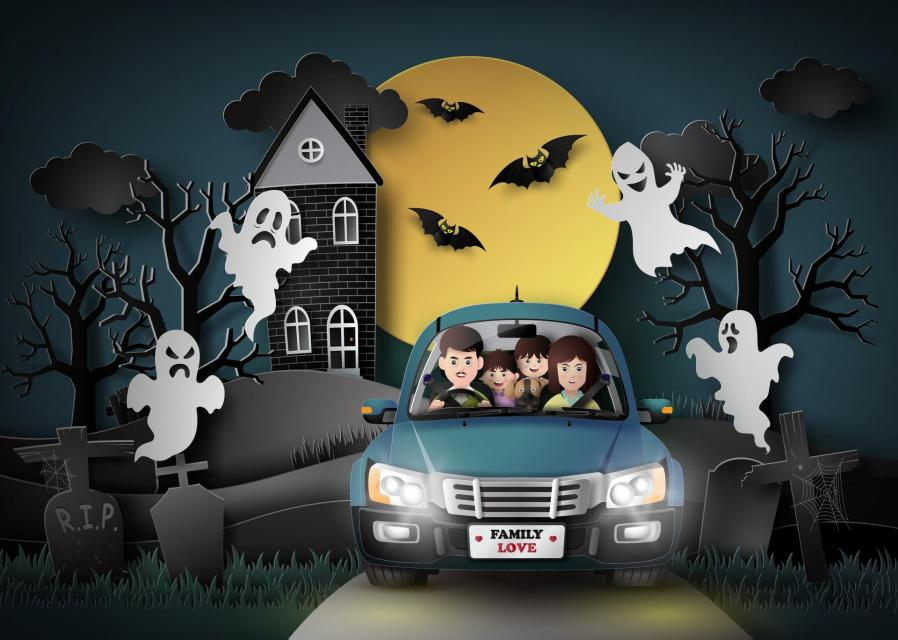 Illustration of family in car driving through ghosts and bats