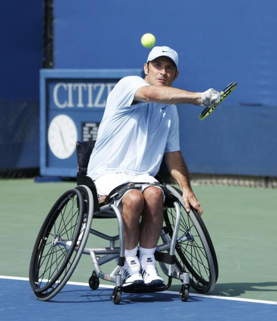Adaptive Tennis player in wheelchair