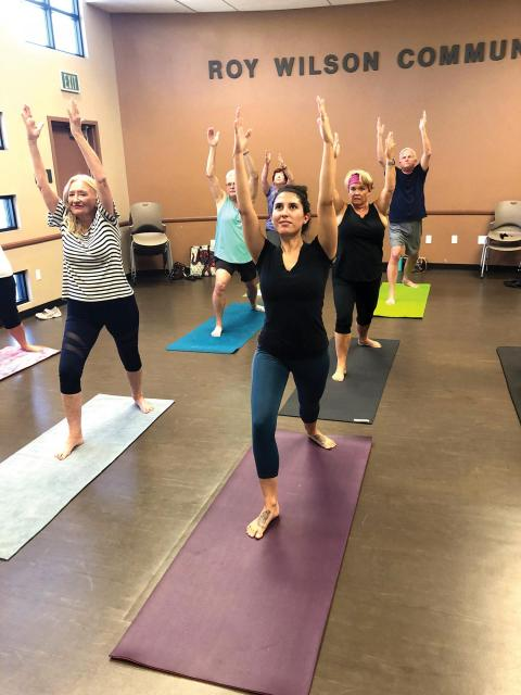 Adults in fitness/yoga class