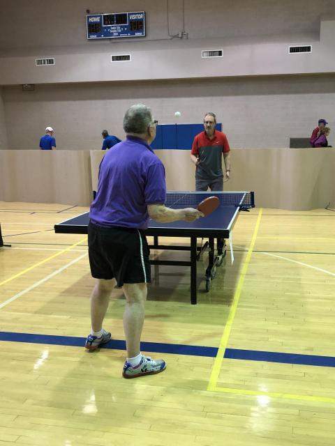 Two people playing table tennis