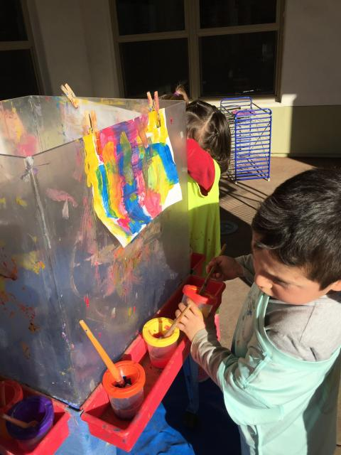 Tot painting on easel