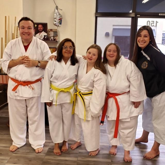 Group of people with special needs in karate uniforms