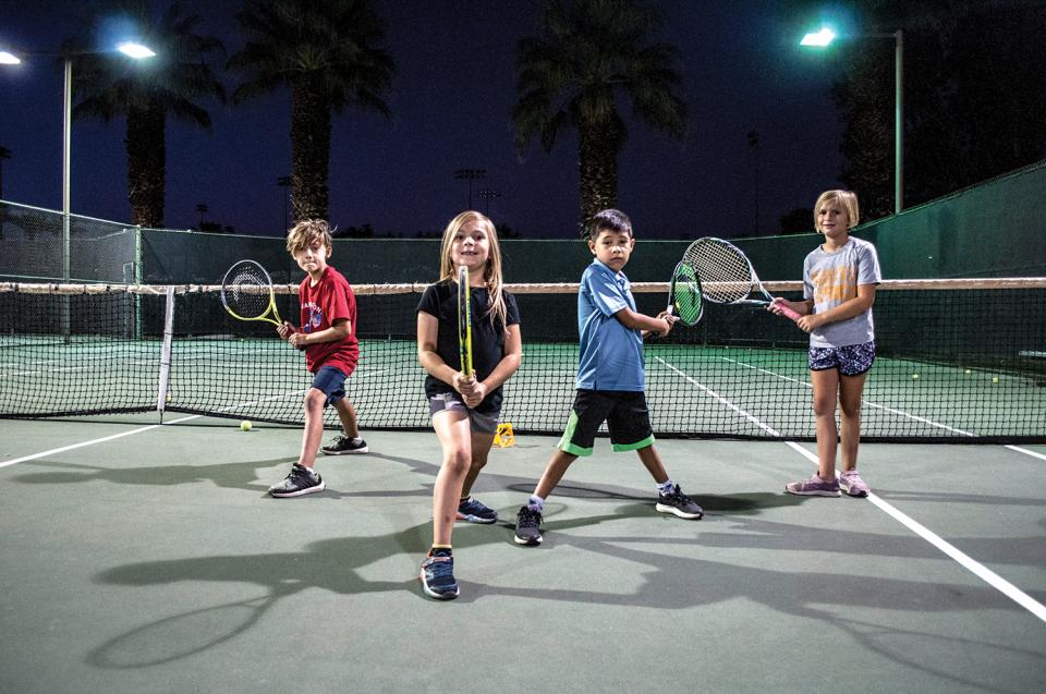 Youth on tennis court