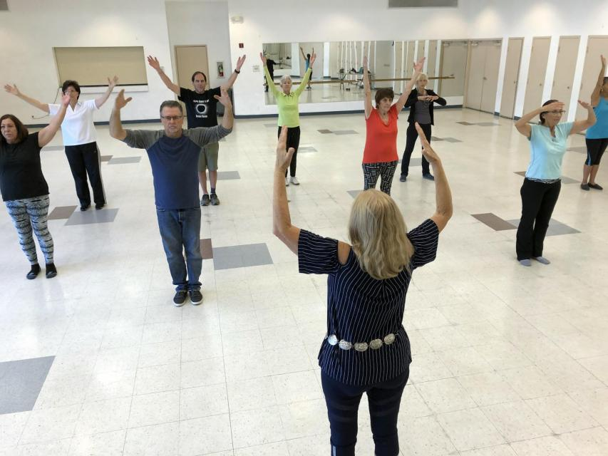 Teacher and students of Tai Chi class indoors