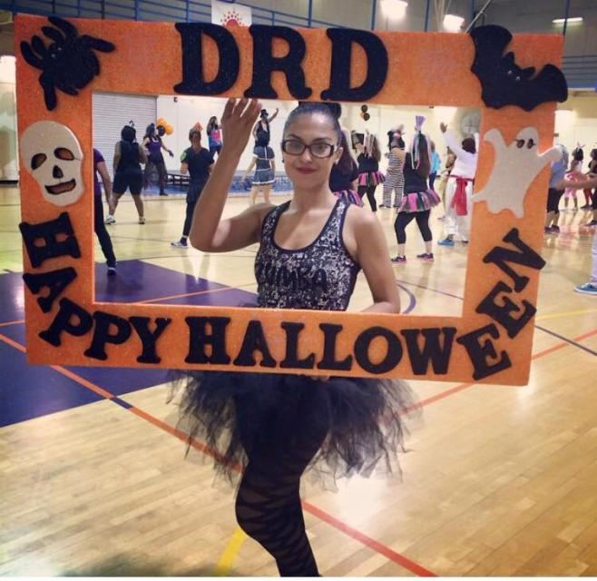 Woman holding DRD Zumbaween sign